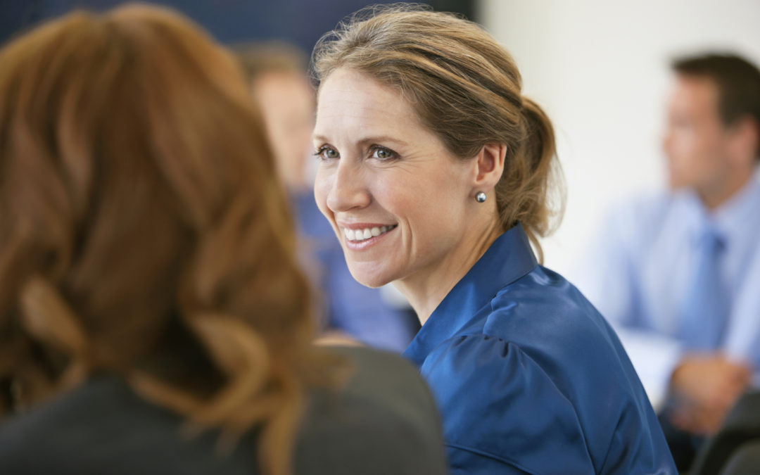 Smiling woman in a meeting in a conference room