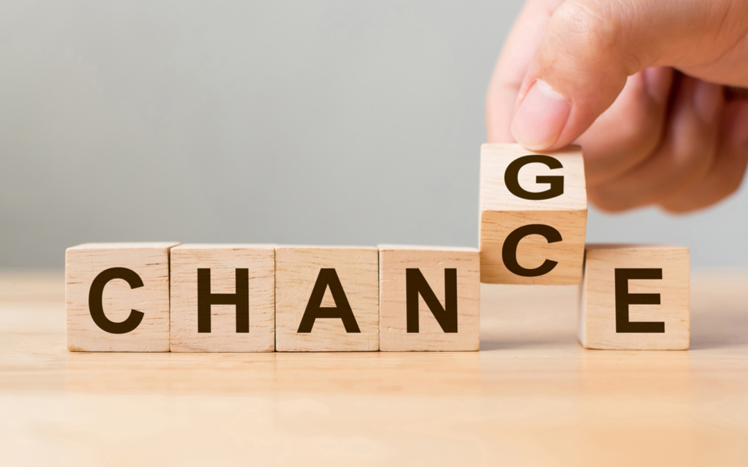 Blocks spelling out chance with man flipping C to G to spell change instead