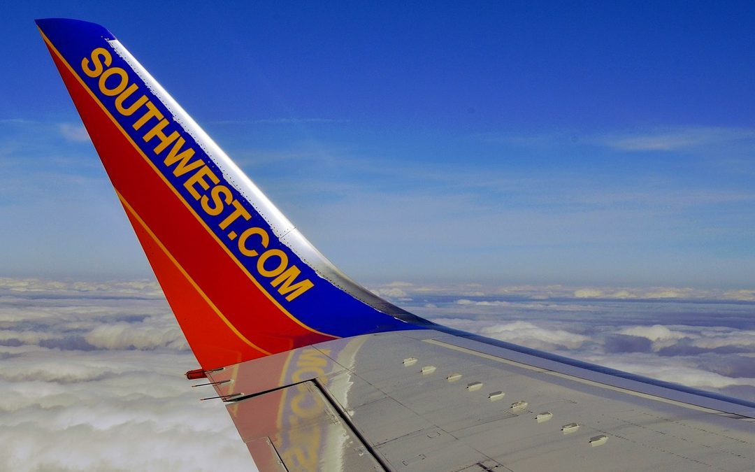 Tip of Southwest Airlines airplane in sky